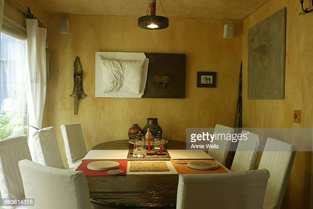 HM0526artists Two artists Myrella Moses and Eric Mondriaan have put together a home filled with fabric This is the diningroom This story looks at how...