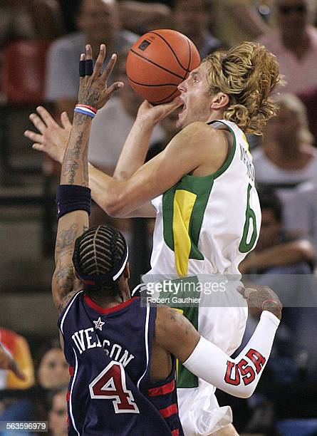 SP0821olybball8RCG–– Allen Iverson pressures Arvydas Macijauskas into a bad shot in the second half as the USA Men's Basketball team goes down in...