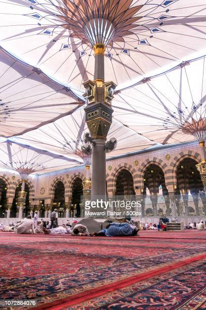 MEDINA-MAR 08:Muslims rest and pray inside of Masjid Nabawi March 08, 2015 in Medina, Saudi Arabia.