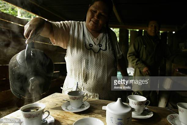 FI1021bolivia Mery Maldonado the named winner of the Cup of Excellence Competition pours boiling water into home made coffee concentrate as she...