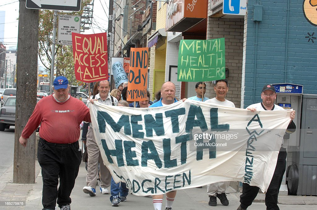ColinMcConnell pics(toronto star) pics of.woodgreen community services and its supporters took to the strets today marching along queen st east to raise awareness of mental health issues as part of mental health awareness week they walkded from jimmie simpson park along queen to jones then back