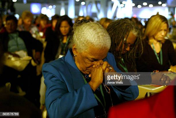 ME1207women Ellinor Cooper bows her head in prayer during the invocation at the 18th California Governor's Conference on Women and Families at the...