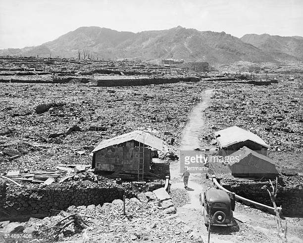 Nagasaki Japan This is a long shot of the center area where the bomb struck A narrow path winds through the masses of debrisall that is left of the...