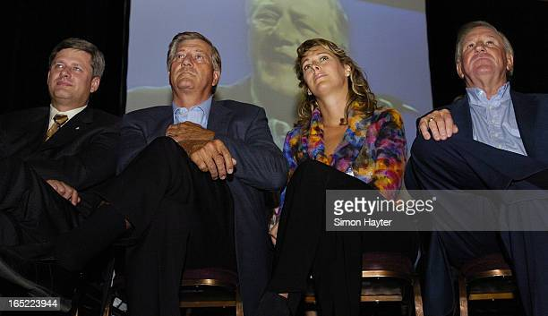 Stephen Harper Mike Harris and his partner Laura McGuire and Erni Eves listen to a video tape of Harris during a presentation for candidate Frank...