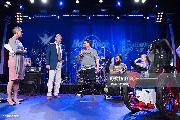 000th track chair recipient Christopher J. Bryde speaks on stage as television journalist Jennifer Griffin, political commentator Bill O'Reilly and...