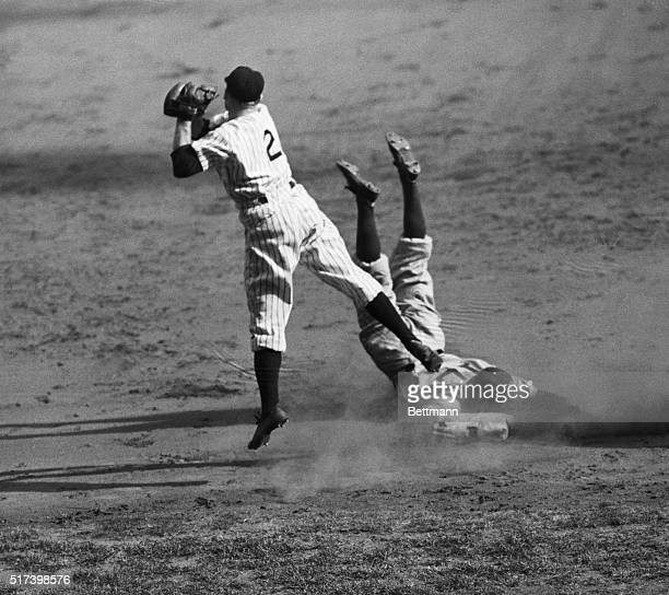 New York, NY: Original caption reads as follows- Catcher Arnold Owen of the Brooklyn Dodgers slides into third base on his triple that scored...