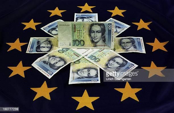 DMnotes lying in a circular shape on a European flag