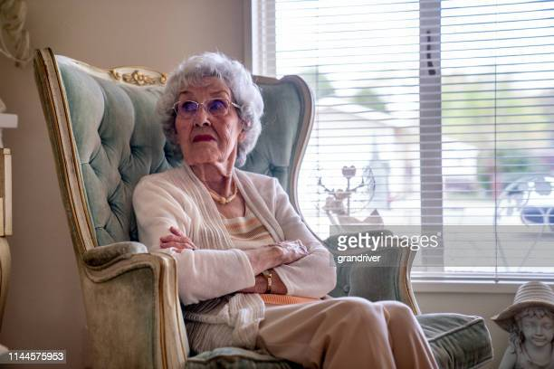 100-year old woman having a cheerful conversation in her home - over 100 stock photos and pictures