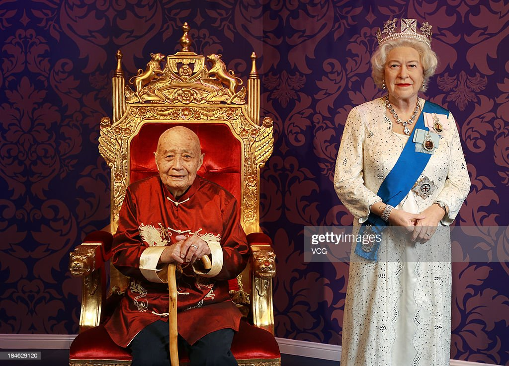 100-year-old Liu Jiayuan poses with a wax figure of Britain's Queen Elizabeth II at Madame Tussauds on October 11, 2013 in Wuhan, China. Wuhan Evening News and Huaxia Qianqiu Education Foundation selected ten healthy centenarians in Wuhan city, and invited them to visit the Madame Tussauds to celebrate the Double Ninth Festival.