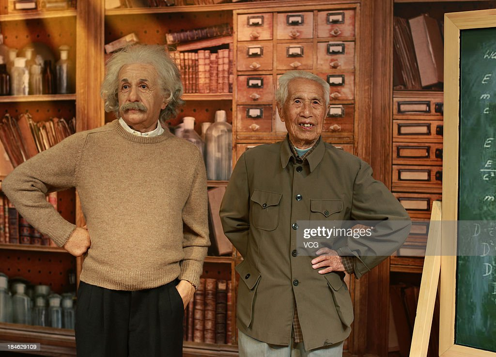 100-year-old Tong Yuqi poses with a wax figure of Albert Einstein at Madame Tussauds on October 11, 2013 in Wuhan, China. Wuhan Evening News and Huaxia Qianqiu Education Foundation selected ten healthy centenarians in Wuhan city, and invited them to visit the Madame Tussauds to celebrate the Double Ninth Festival.