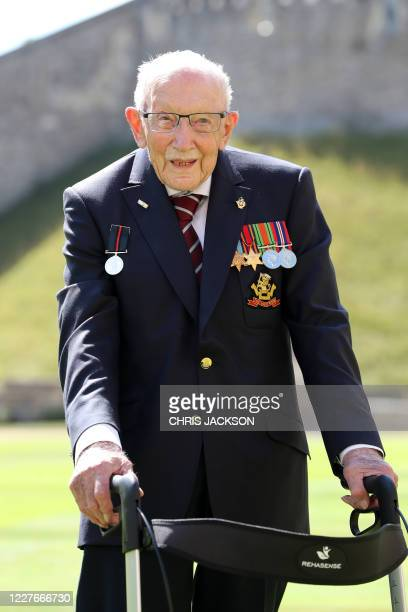 Year-old WWII veteran Captain Tom Moore attends an investiture where he will be made a Knight Bachelor during at Windsor Castle in Windsor, west of...