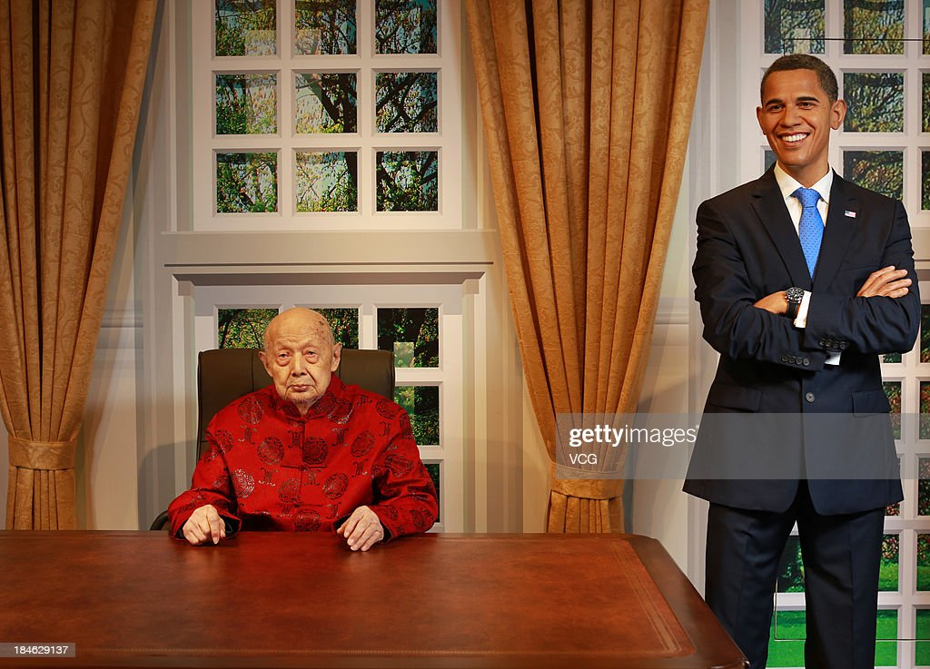 100-year-old Yu Ruihai poses with a wax figure of U.S. President Barack Obama at Madame Tussauds on October 11, 2013 in Wuhan, China. Wuhan Evening News and Huaxia Qianqiu Education Foundation selected ten healthy centenarians in Wuhan city, and invited them to visit the Madame Tussauds to celebrate the Double Ninth Festival.