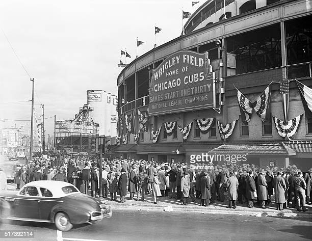 Chicago, Illinois-Crowds of sports fans mill around the Wrigley Field Box Office where reserved seats for the final Tigers-Cubs World Series meet...