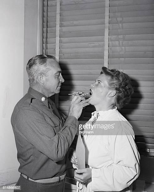 New York NY WAC volunteer gets dental examination by Chief of Dental Service