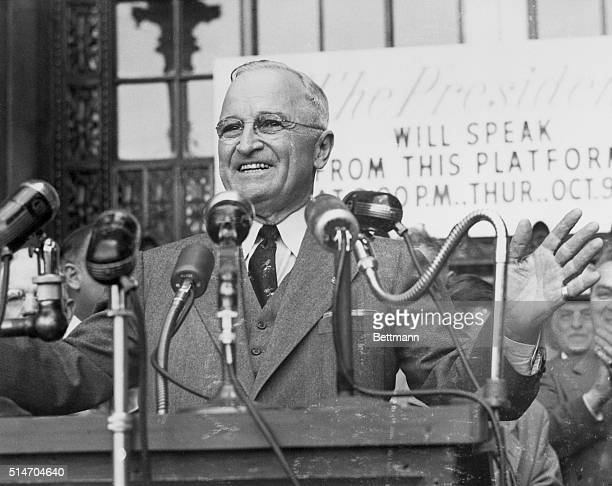 Cleveland OH President Truman responds with a warm smile as he is greeted by an estimated 30000 persons in Cleveland's Public Square Oct 9 The...