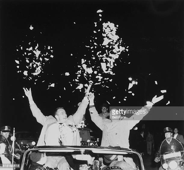 Milwaukee WI Braves' hurlers Lew Burdette and Warren Spahn toss confetti during a parade welcoming home the new world champs of baseball Between them...