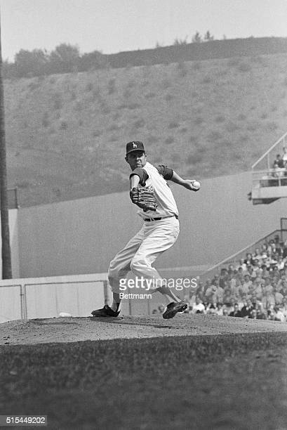 Los Angeles California Pitching giant Don Drysdale appears to mean business as he bears down in the fifth inning of the World Series game Drysdale...