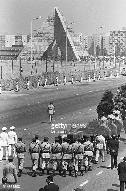 Cairo Egypt Gun carriage bears the coffin of slain Preident Anwar Sadat 10/10 to his burial at the pyramidshaped Tomb of the Unknown Soldier rear0...