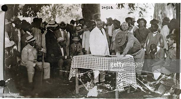 American occupation of Haiti Signing of final peace pact at Cape Haitian In the center in white is the American council The man signing the document...