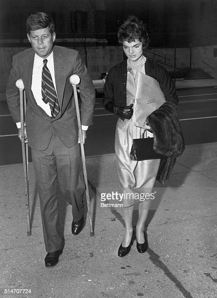 Senator John F Kennedy Massachusetts Democrat hobbles on crutches into the hospital for special surgery in New York to undergo an operation for a war...