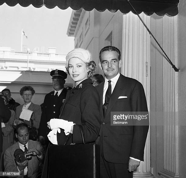 Washington, DC: Prince Ranier and Princess Grace of Monaco leave the White House here October 11 following their 30-minute visit with President...
