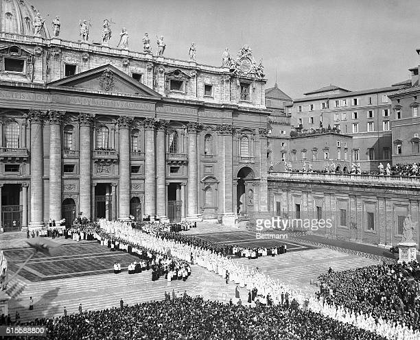 Vatican City, Italy- White-clad Council Fathers walk into St. Peter's Basilica early October 11th, at the beginning of the world's 21st Ecumenical...
