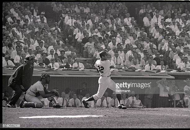 Los Angeles CA Helping his own game Dodger pitcher Sandy Koufax slams a single to left center with Ron Fairly on second and John Roseboro who was...