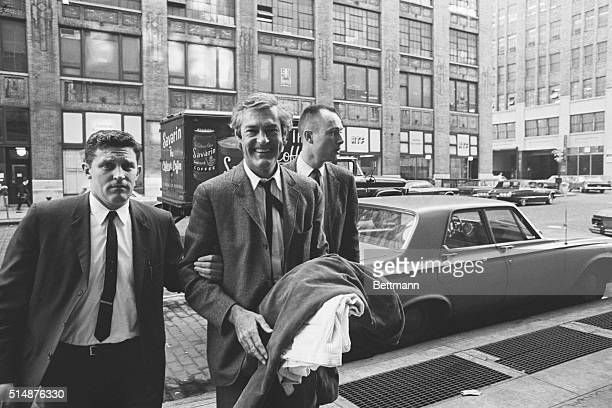 In the custody of customs officials Dr Timothy Leary is led into US customs house here Oct 11 following his arrest at La Guardia Airport Dr Leary the...