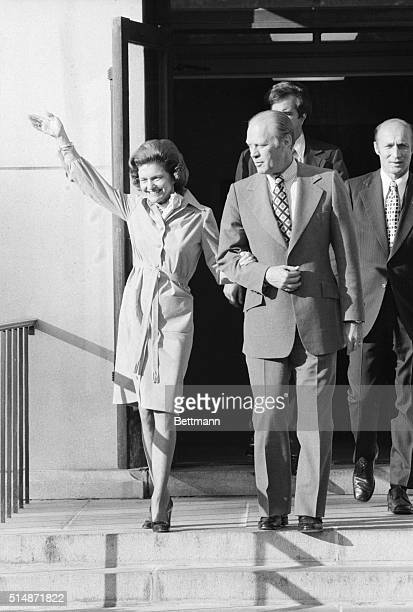 Washington, D.C.: Photo shows President Gerald Ford assisting his wife, Betty, down the stairs as she left for Bethesda Naval Hospital recently,...