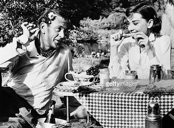 10/1/1956Paris France Gary Cooper playing the role of a philandering American is shown wooing Audrey Hepburn at a De Luxe picnic for two in their new...