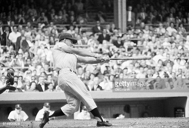 10/1/1961New York NY Roger Maris swings and hits his 61st homer of the season to surpass the alltime high of Babe Ruth and place a new record in the...