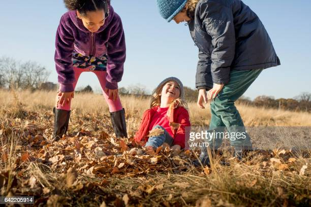 10-11years, 4-5 years playing in the park, autumn leaves - 10 11 years stock pictures, royalty-free photos & images