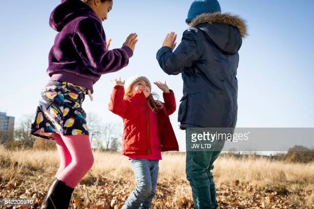 10-11years 4-5 years playing in the park, high fives - 4 5 years photos stock pictures, royalty-free photos & images