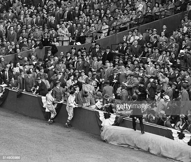 Second baseman Al Schoendienst and first baseman Stan Musial made a vain gallop to the boxes to try for Bobby Doerr's foul in the 6th inning at...