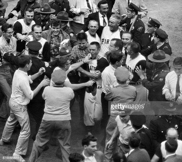Forbes Field Pittsburgh PA Fans and players mob Pirates'Bill Mazeroski after his ninth inning homer that gave the Pirates the 1960World Series One...