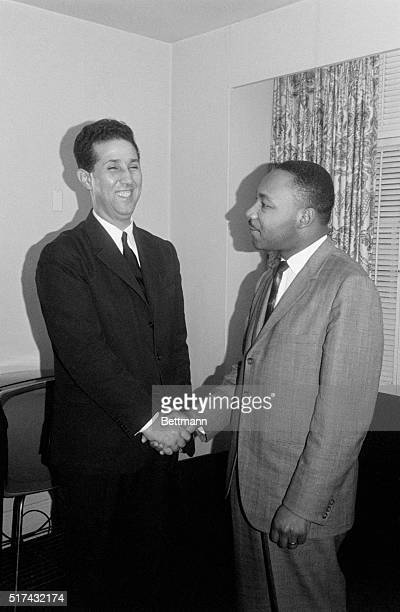 New York New York Algerian Premier Ahmed Ben Bella gives a big smile as he shakes hands with integration leader Rev Martin Luther King during a...
