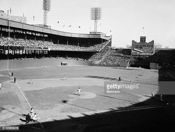 New York NY Joe DiMaggio the Yankee Clipper is shown the instant after he slammed a tworun homer into the upper deck of the leftfield stands at the...