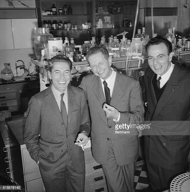 Paris, France: French winners of the Nobel Prize for Medicine--from left: Jacques Monod, Andre Lwoff, and Francois Jacob--smile in their laboratory...