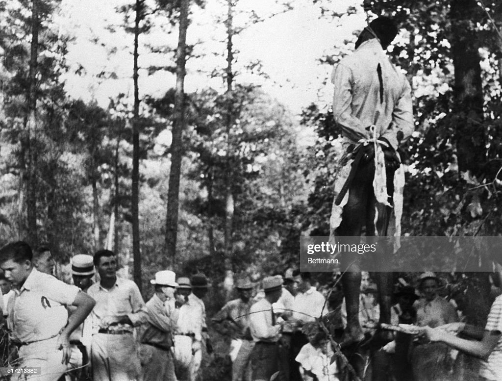 Lynching Victim Hangs Above White Crowd : News Photo