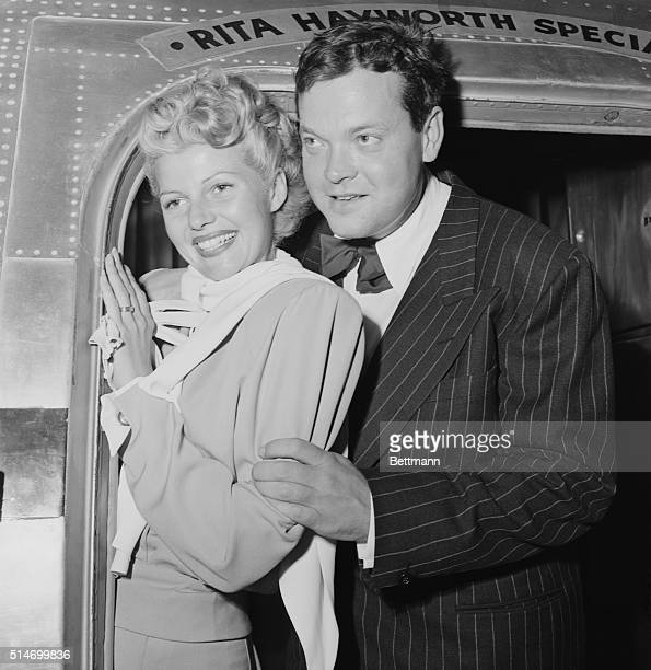 Los Angeles CA Their rumored disagreement apparently ended Rita Hayworth glamorous film star and her husband Orson Welles wave from their plane the...