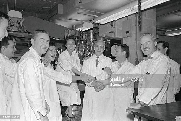 New York NY Dr Severo Ochoa gets a multiple handshake and hearty congratulations from colleagues in his laboratory at the New York University Medical...