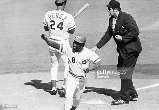 Cincinnati, OH: A jubilant Joe Morgan waves to the crowd as he crosses home plate on a first inning home run against the Yankees in the World Series...