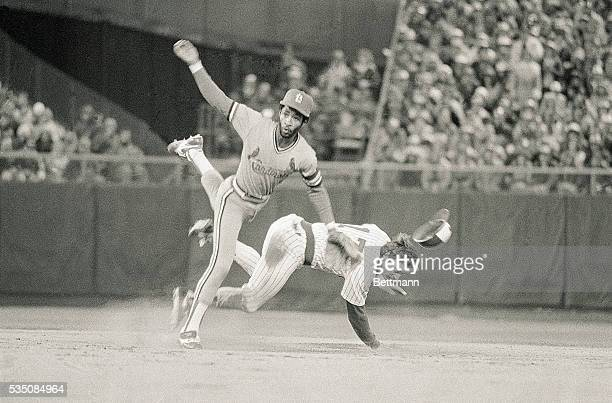 MilwaukeeWICards' shortstop Ozzie Smith fires to first for a double play in the 6th inning of game of the World Series 10/15 Brewers' Jim Gantner is...