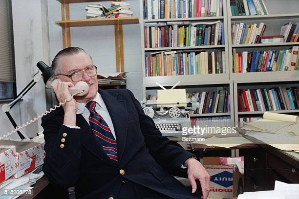 Fairfax VA Prof James McGill Buchanan of George Mason Univ talks on the telephone soon after it was announced that he was awarded the 1986 Nobel...