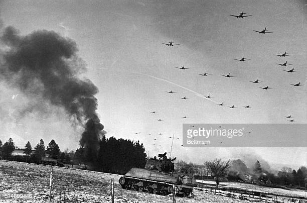 Smoke billows from direct hits on rolling stock during the heavy attack by the Ninth Bombardment Division marauder medium bombers over the important...