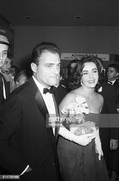 New York NY Linked romantically in Hollywood actress Elizabeth Taylor and producer Michael Todd arrive at the premiere of Todd's new movie 'Around...