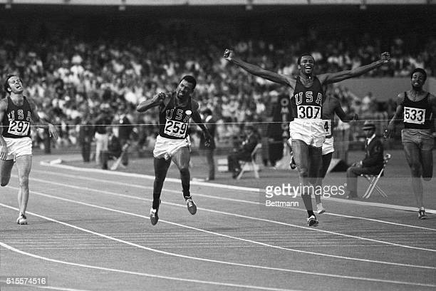 Mexico City: Tommie Smith of Lemore, Calif., throws his arms up in victory as he hits the tape to win a gold medal in the men's 200-meter dash Oct....