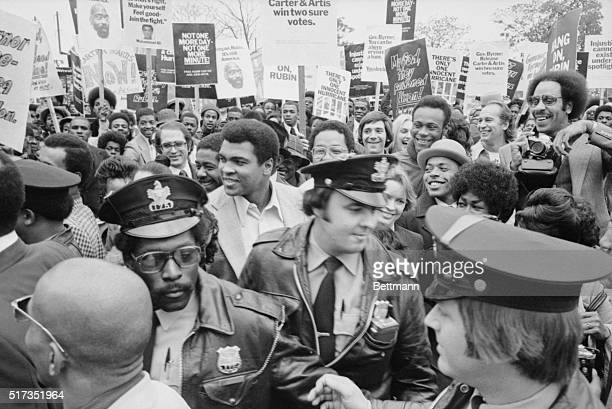 Trenton NJ Heavyweight champion Muhammad Ali leads a rally of some 1600 people through the streets of Trenton in an effort to convince New Jersey...