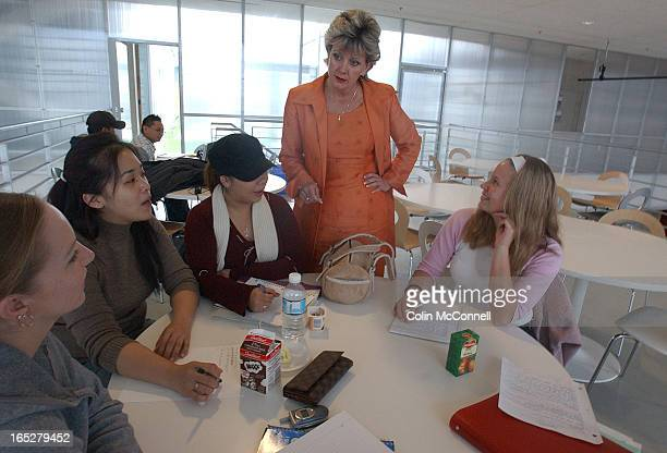 10/18/04pics of centen nial president ann buller she is the first college pres who is a college grad herselfshots of her alone and talking to some...