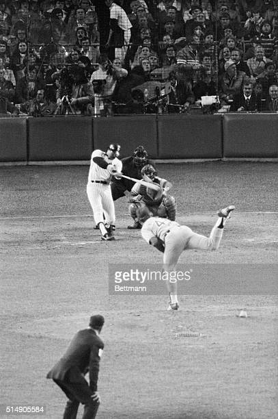 New York, NY: Yankees' Reggie Jackson connects for a two-run homer off L.A. Dodgers' Burt Hooten in fourth inning to give the Yankees a 4-3 lead in...